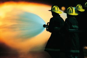 Firemen spraying water on fire