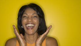Mature woman laughing, close-up