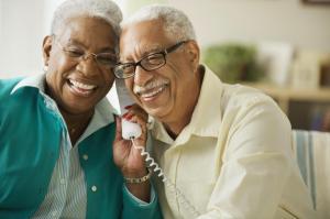Elderly couple talking on the phone