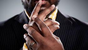 Close up studio portrait of mid adult businessmans hands