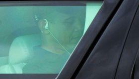 US President Barack Obama uses headphone