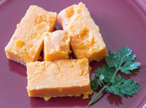 English red leicester hard ripened cheese. Four blocks of...