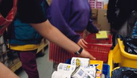Volunteers Distribute Baskets of Food at a Food Pantry