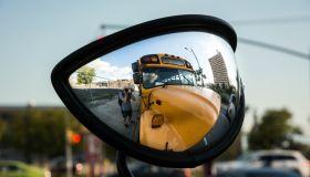 Photographer Taking Self Portrait In Side-View Mirror Of School Bus