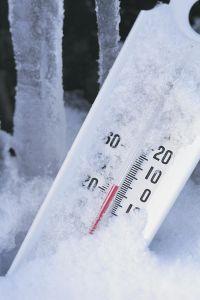 Thermometer registers below zero in snow
