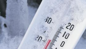 Thermometer registers below zero in snow