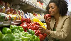 Woman holding red pepper
