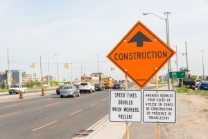 Construction ahead sign next to construction zone with...