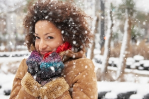 Young woman enjoying snowfall