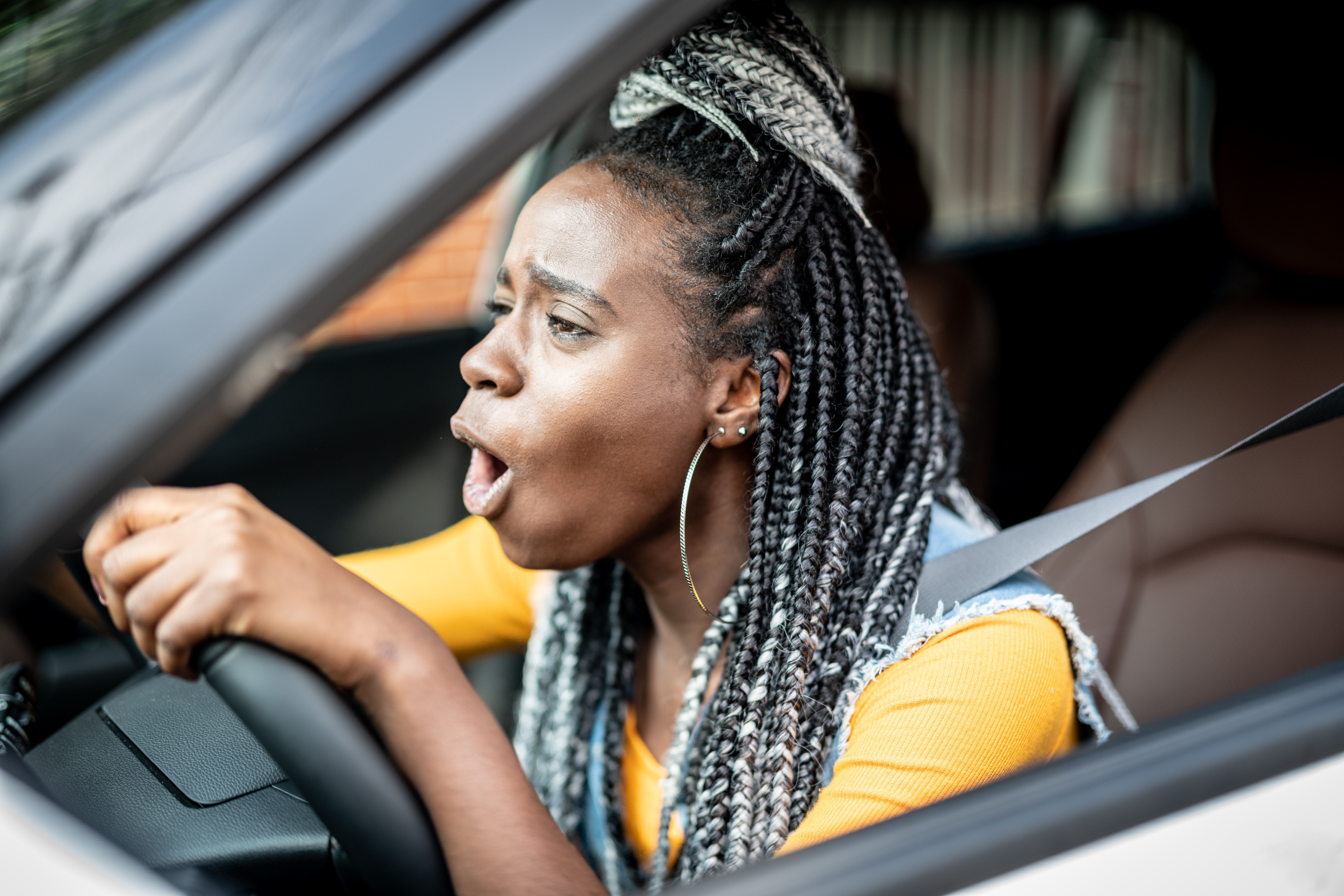 Portrait of Stressed African Woman In Car