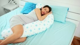 Pregnant woman sleeping.