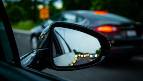 Close-up of a wing mirror in a traffic jam, United States