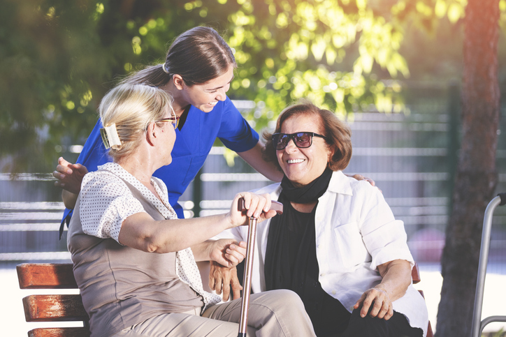 Nurse helping old women for comfort and care