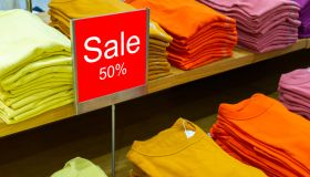 Sale mock up advertise display frame in the shopping department store. Shopping sale sign 50% sale at adepartment. Shopping concept, Advertisement concept