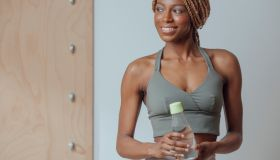 Sportswoman Holding Bottle of Water