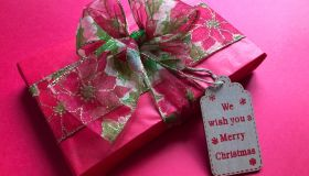 High Angle View Of Gift With Text Tag Over Pink Background