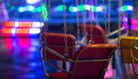 Close-Up Of Swing Ride At Night