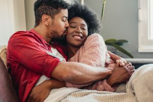 Portrait of couple relaxing at home