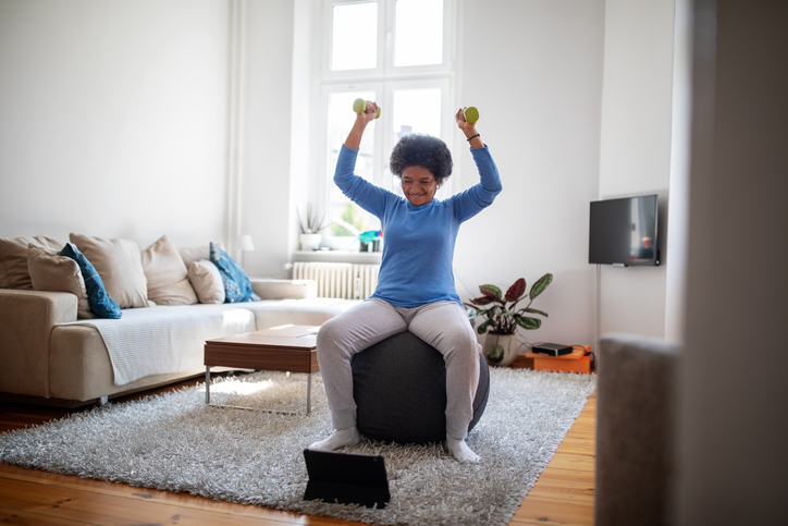 Woman is doing online workout during covid-19 lockdown