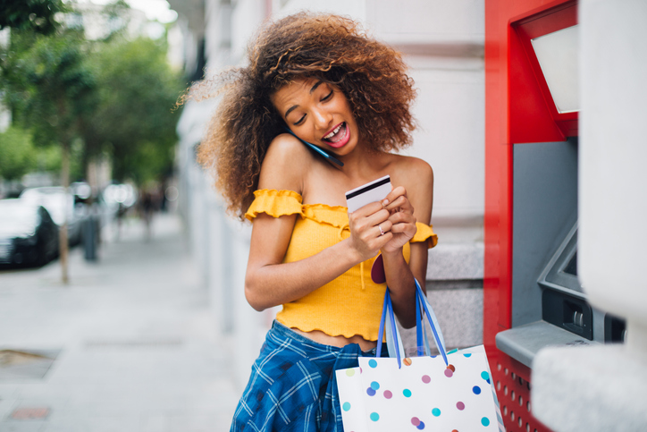 Afro girl shopping and banking downtown