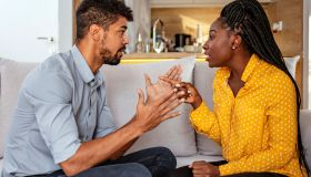 Black woman and man quarrelling at home