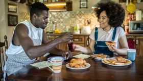 Afro American couple having breakfast in their home