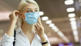 Woman wearing medical mask in shopping center