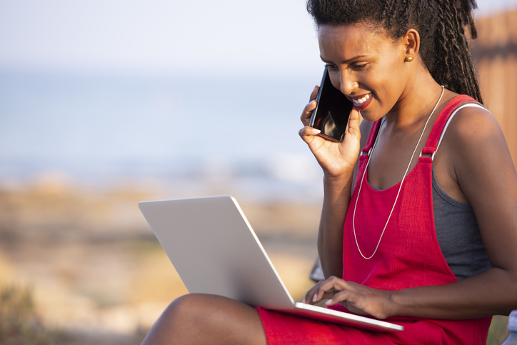 Freelancer woman working online outdoors.