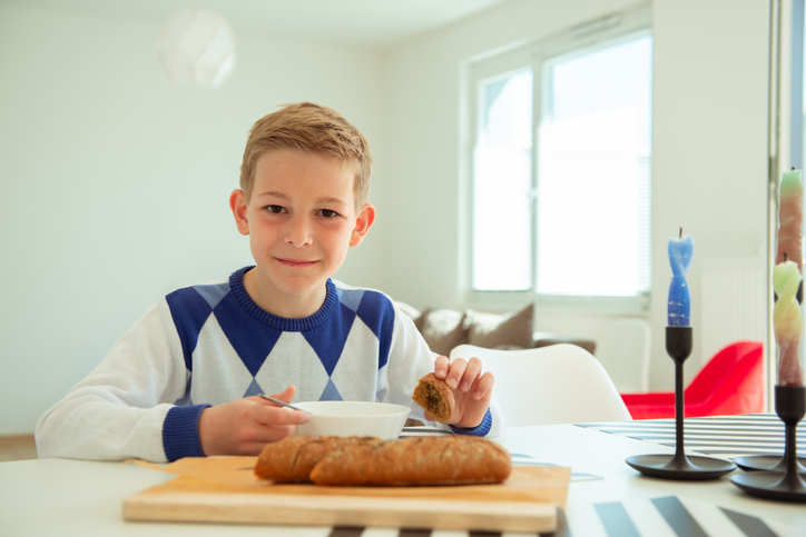 Portrait Of Boy On Table