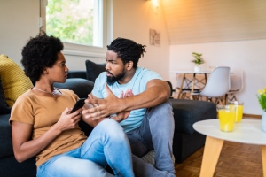Frustrated black couple arguing.