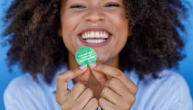 African Woman With COVID-19 Vaccine Sticker