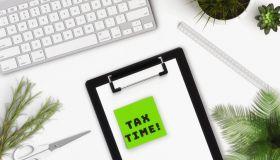 tax refund concept.Calculator, pen, paper,
