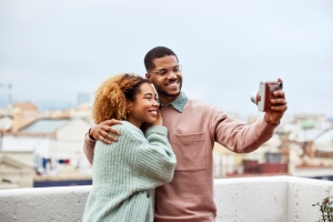 Happy Man Taking Selfie With Girlfriend At Rooftop