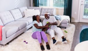 Senior African-American couple exercising at home