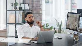 Shot of a young businessman looking thoughtful while working on a laptop in an office