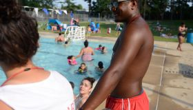 Arrindell pauses at one of the chairs to talk to a fellow lifeguard.Wensy Arrindell, a manager at Schlegel Park pool, helps the lifeguards keep hundreds of swimmers safe daily. Summer Jobs story. Photo by Jeremy Drey 6/30/2017
