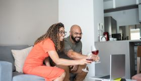 Couple drinking wine during a virtual happy hour at home