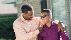 Proud African American father with teenage son