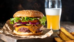Cheeseburger Burger Patty classic with french fries and beer menu on rustic board of wood