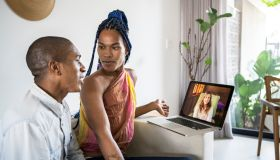 African American Non-binary person and transgender woman in video call of couple online psychotherapy. Telemedicine and mental healthcare concept.