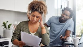 Shot of a couple having an argument while going over their finances at home